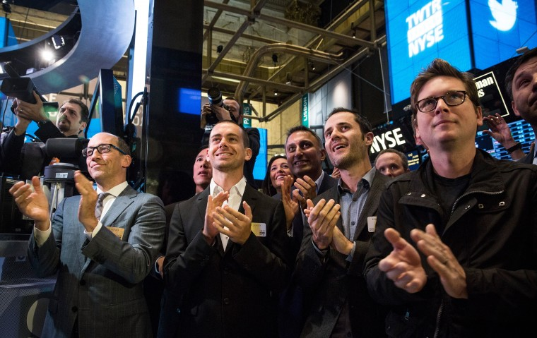 Twitter CEO Dick Costolo, Twitter co-founder Jack Dorsey, Twitter co-founder Evan Williams and Twitter co-founder Biz Stone applaud as Twitter rings the opening bell at the New York Stock Exchange (NYSE) while also celebrating the company's IPO on November 7, 2013 in New York City. Twitter went public November 7, on the NYSE selling at a market price of $45.10, with the initial price being set at $26 on November 6. (Andrew Burton/Getty Images)