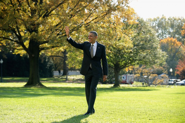 "U.S. President Barack Obama waves to guests as he departs the White House November 8, 2013 in Washington, DC. According to the White House, Obama is traveling to New Orleans for an event where he will talk about the ""importance of taking measures to grow the economy and create jobs by increasing our exports"" and then he will travel onto Miami for fund raising events. (Chip Somodevilla/Getty Images)"