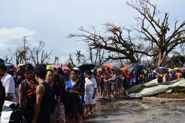 Affected residents wait in line for relief goods at a heavily damaged airport on November 10, 2013 in Tacloban City, Leyte, Philippines. Typhoon Haiyan, packing maximum sustained winds of 195 mph (315 kph), slammed into the southern Philippines and left a trail of destruction in multiple provinces, forcing hundreds of thousands to evacuate and making travel by air and land to hard-hit provinces difficult. Around 10,000 people are feared dead in the strongest typhoon to hit the Philippines this year. (Dondi Tawatao/Getty Images)
