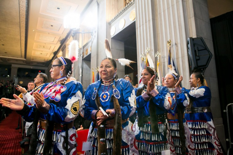 Native American women military veterans stand in the audience during U.S. President Barack Obama's speech at the 2013 Tribal Nations Conference held at the Department of Interior Building on November 13, 2013 in Washington, DC. Obama meet with leaders of 566 Native American tribes earlier in the day at teh White House. (Kristoffer Tripplaar-Pool/Getty Images)