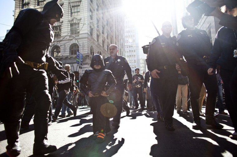 Police escorts 5-year-old leukemia survivor Miles, also known as BatKid and Batman after they arrest the Riddler November 15, 2013 in San Francisco. Make-A-Wish Greater Bay Area foundation turned the city into Gotham City for Miles by creating a day long event bringing his wish to be a BatKid to life. (Ramin Talaie/Getty Images)