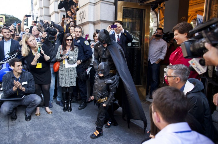 5-year-old leukemia survivor Miles, also known as BatKid and Batman leave a former bank after arresting the Riddler November 15, 2013 in San Francisco. Make-A-Wish Greater Bay Area foundation turned the city into Gotham City for Miles by creating a day long event bringing his wish to be a BatKid to life. (Ramin Talaie/Getty Images)