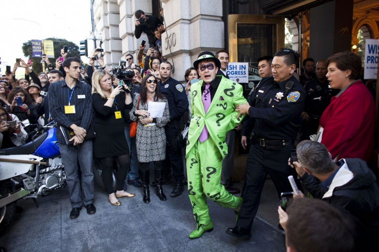 San Francisco police officers arrest the Riddler with the help of 5-year-old leukemia survivor Miles, also known as BatKid November 15, 2013 in San Francisco. Make-A-Wish Greater Bay Area foundation turned the city into Gotham City for Miles by creating a day long event bringing his wish to be a BatKid to life. (Ramin Talaie/Getty Images)