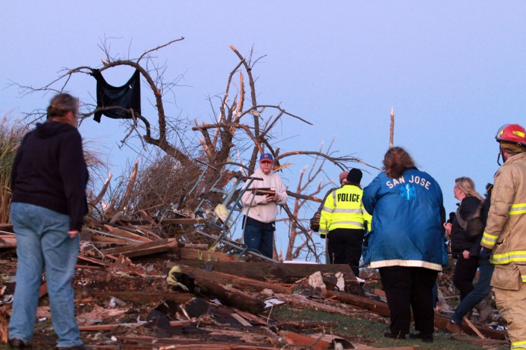 Residents of Elgin Avenue sort through debris after a tornado struck Washington, Ill. (Photo by Tasos Katopodis/Getty Images)