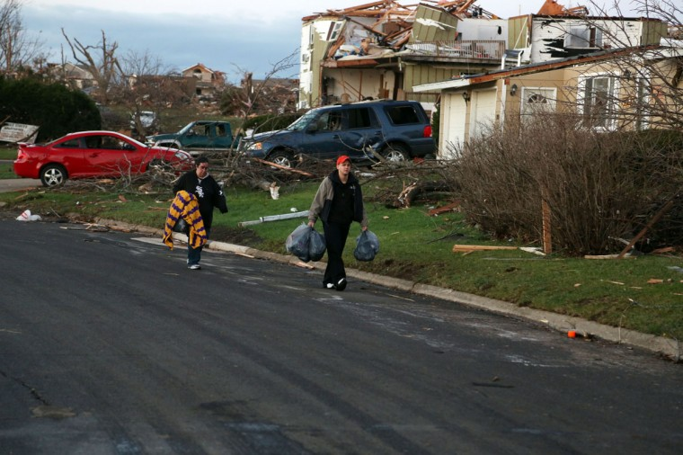 Residents of Elgin Avenue salvage what remains after a tornado struck Washington, Ill. (Photo by Tasos Katopodis/Getty Images)