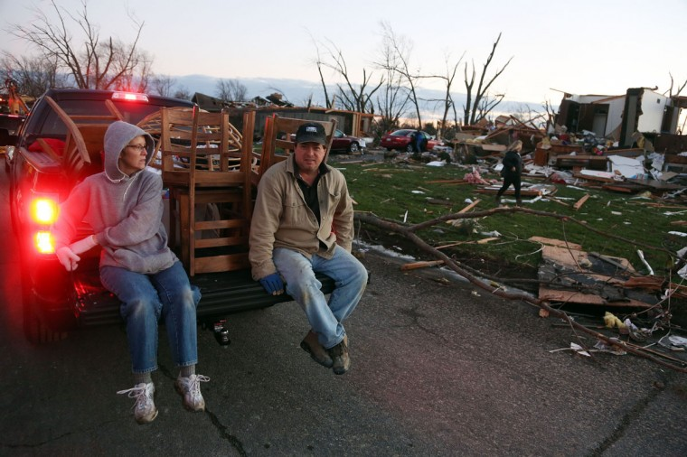 Tina Junk and Gary Junk, residents of Elgin Avenue, salvage what remains after a tornado struck Washington, Ill. (Photo by Tasos Katopodis/Getty Images)