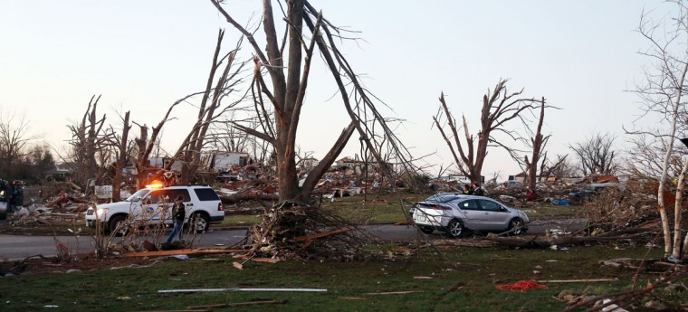 Residents of Elgin Avenue survey damage after a tornado struck Washington, Ill. (Photo by Tasos Katopodis/Getty Images)