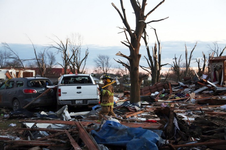 A firefighter walks through debris after a tornado struck Washington, Ill. Several tornadoes touched down across the Midwest, with at least three people reported dead in Illinois. (Photo by Tasos Katopodis/Getty Images)