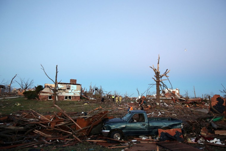 Residents sort through debris after a tornado struck Washington, Ill. (Photo by Tasos Katopodis/Getty Images)