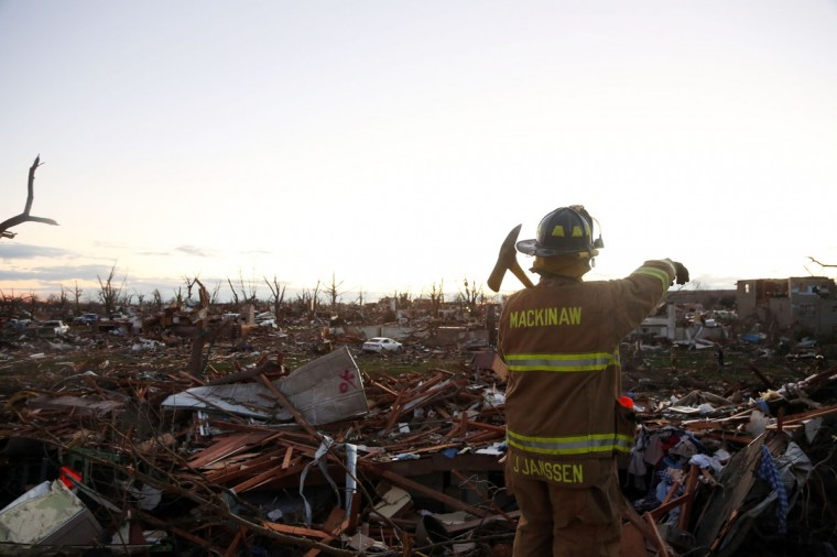 Jeremy Janssen of Mackinaw Fire Department works amongst the debris after a tornado struck Washington, Ill. (Photo by Tasos Katopodis/Getty Images)