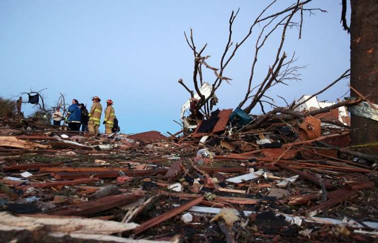 Residents and firefighters sort through debris after a tornado struck Washington, Ill. (Photo by Tasos Katopodis/Getty Images)