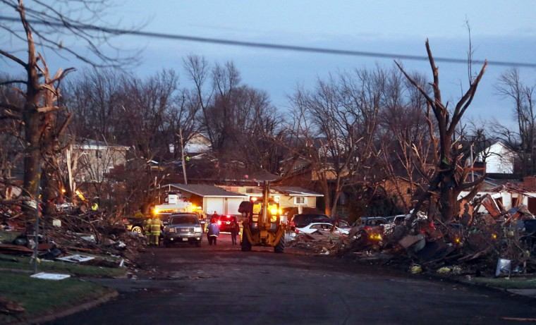 The damage is surveyed along Elgin Avenue after a tornado struck Washington, Ill. (Photo by Tasos Katopodis/Getty Images)