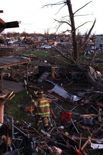 A firefighter searches through debris after a tornado struck Washington, Ill. (Photo by Tasos Katopodis/Getty Images)