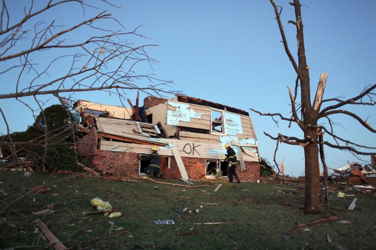 Firefighters search a heavily damaged home after a tornado struck Washington, Ill. (Photo by Tasos Katopodis/Getty Images)