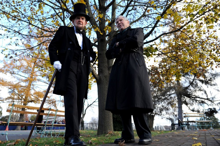 Portraying U.S. President Abraham Lincoln, James Getty (left) stands behind stage with keynote speaker and Pulitzer Prize author, James McPherson, before reciting the Gettysburg Address during a commemoration of the 150th Anniversary of the Gettysburg Address at the Soldiers' National Cemetery at Gettysburg National Military Park on November 19, 2013 in Gettysburg, Pennsylvania. The iconic Gettysburg Address speech was first given by U.S. President Abraham Lincoln in 1863 during the Civil War. (Patrick Smith/Getty Images)
