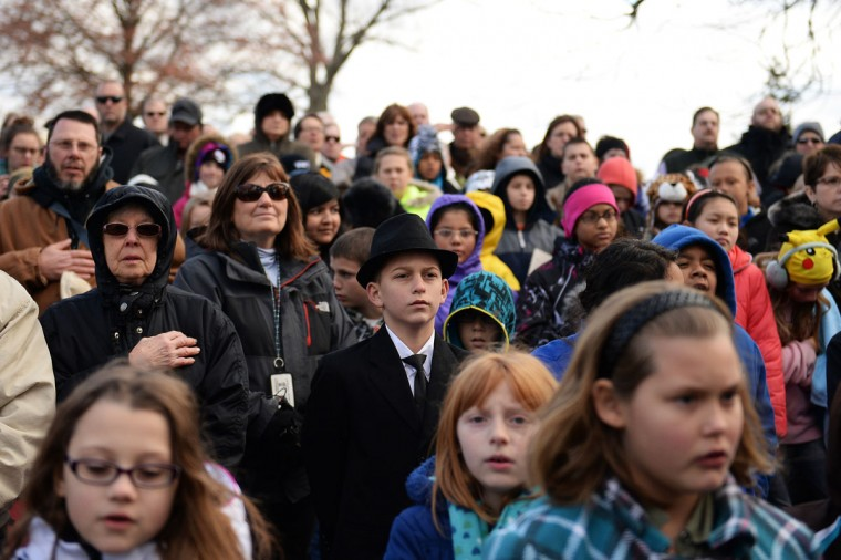 "A young visitor dressed as U.S. President Abraham Lincoln listens to speakers during a commemoration of the 150th Anniversary of the Gettysburg Address at the Soldiers' National Cemetery at Gettysburg National Military Park on November 19, 2013 in Gettysburg, Pennsylvania. The iconic Gettysburg Address was given by U.S. President Abraham Lincoln in 1863 during the Civil War and highlighted the principles of democracy, human equality, and freedom and professed that ""government of the people, by the people, for the people, shall not perish from the earth."". (Patrick Smith/Getty Images)"