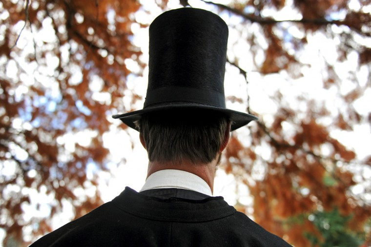 "Portraying U.S. President Abraham Lincoln, a visitor listens to speakers during a commemoration of the 150th Anniversary of the Gettysburg Address at the Soldiers' National Cemetery at Gettysburg National Military Park on November 19, 2013 in Gettysburg, Pennsylvania. The iconic Gettysburg Address was given by U.S. President Abraham Lincoln in 1863 during the Civil War and highlighted the principles of democracy, human equality, and freedom and professed that ""government of the people, by the people, for the people, shall not perish from the earth."" (Patrick Smith/Getty Images)"