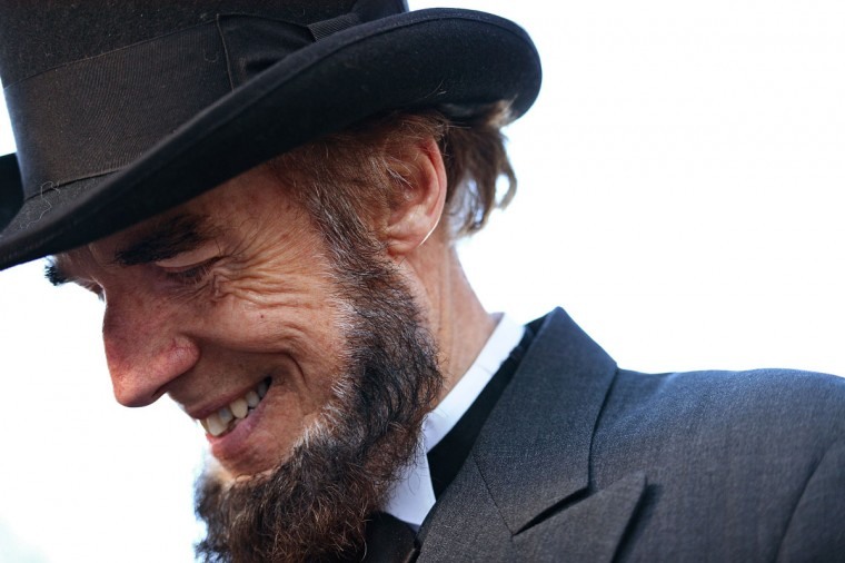 "Portraying U.S. President Abraham Lincoln, Tom Scott, talks to visitors during a commemoration of the 150th Anniversary of the Gettysburg Address at the Soldiers' National Cemetery at Gettysburg National Military Park on November 19, 2013 in Gettysburg, Pennsylvania. The iconic Gettysburg Address was given by U.S. President Abraham Lincoln in 1863 during the Civil War and highlighted the principles of democracy, human equality, and freedom and professed that ""government of the people, by the people, for the people, shall not perish from the earth."" (Patrick Smith/Getty Images)"