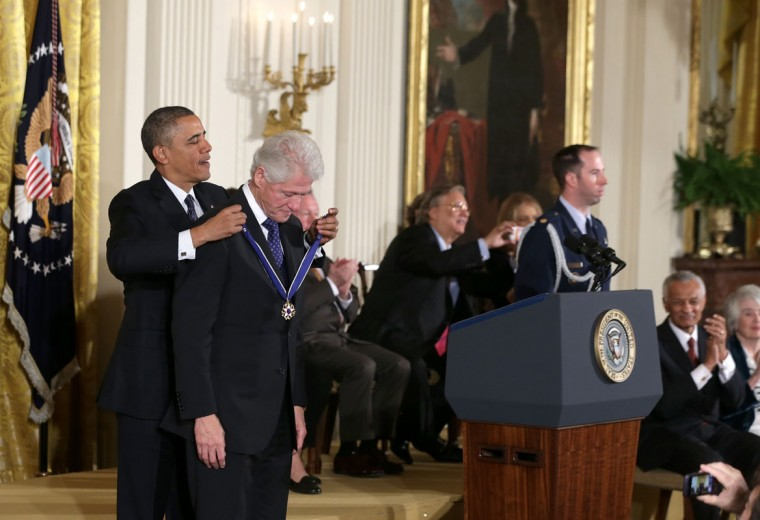 U.S. President Barack Obama (L) awards the Presidential Medal of Freedom to former U.S. President Bill Clinton in the East Room at the White House on November 20, 2013 in Washington, DC. The Presidential Medal of Freedom is the nation's highest civilian honor, presented to individuals who have made meritorious contributions to the security or national interests of the United States, to world peace, or to cultural or other significant public or private endeavors. (Alex Wong/Getty Images)