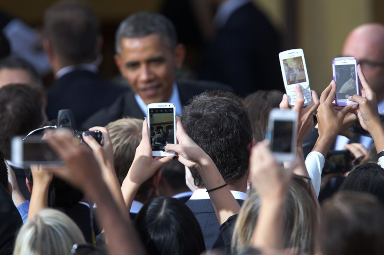 People use smart phones to photograph U.S. President Barack Obama as he greets them after delivering remarks on the economy at DreamWorks Animation on November 26, 2013 in Glendale, California. The president is visiting DreamWorks and fundraising events during a two-day visit to southern California. (David McNew/Getty Images)