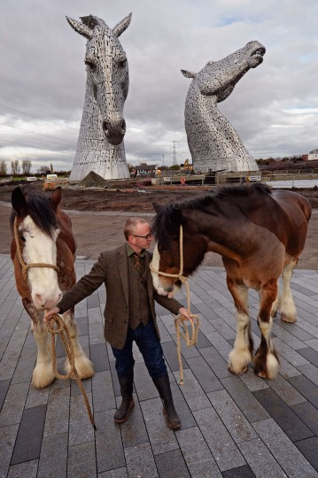 Andy Scott stands with Clydesdale Horses Duke and Baron during a topping out ceremony at The Kelpies on November 27, 2013 in Falkirk, Scotland. Construction work has been completed on Andy Scott's Kelpies, the world's largest pair of equine sculptures and one of the UKs tallest pieces of public art. The 30 metre tall Kelpies have cost Â5million to complete and play a central role in the £43 million, 350-hectare Helix land transformational project between Falkirk and Grangemouth. (Jeff J Mitchell/Getty Images)