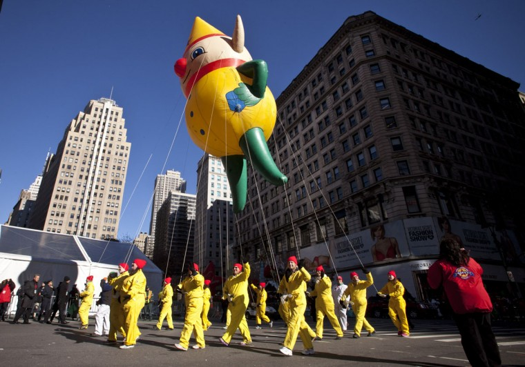 A Santa's Elf balloon floats above the street during the Macy's Thanksgiving Day Parade on November 28, 2013 in New York City. (Photo by Kena Betancur/Getty Images)