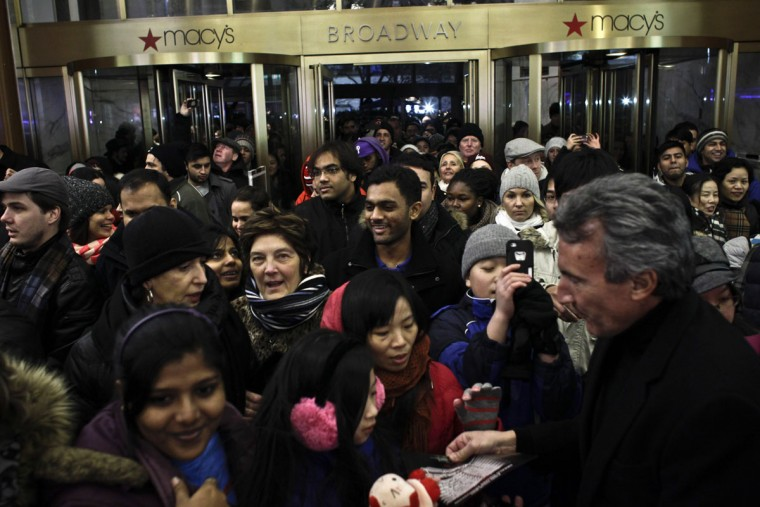 People enter Macy's Herald Square as the store opens its doors at 8 pm Thanksgiving day on November 28, 2013 in New York City. Black Friday shopping began early again this year with most major retailers opening their doors on Thanksgiving day. (Kena Betancur/Getty Images)