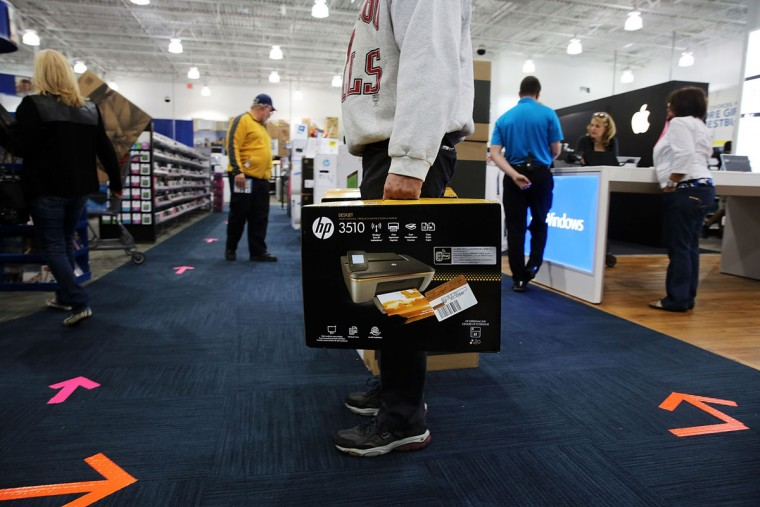 Black Friday shoppers carry away discounted items from at a Best Buy store which opened its doors at 6pm on Thanksgiving Day this year on November 29, 2013 in Naples, Florida. One of the busiest days in the calendar for retailers, over a dozen US stores opened their doors to shoppers one day ahead of the famed-Black Friday shopping day. (Spencer Platt/Getty Images)
