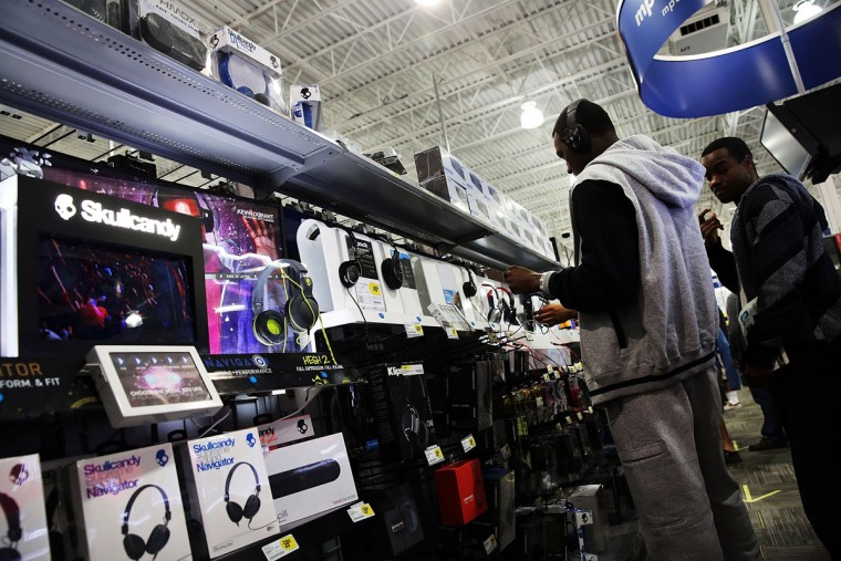 Black Friday shoppers looks for deals at a Best Buy store which opened its doors at 6pm on Thanksgiving Day this year on November 29, 2013 in Naples, Florida. One of the busiest days in the calendar for retailers, over a dozen US stores opened their doors to shoppers one day ahead of the famed-Black Friday shopping day. (Spencer Platt/Getty Images)