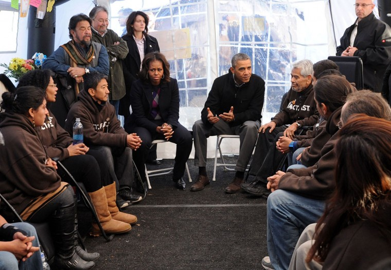 U.S. President Barack Obama (7th R) meets with people taking part in the Fast For Families on the National Mall in support of immigration reform as first Lady Michelle Obama (7th L) looks on November 29, 2013, in Washington, DC. Obama visited the protestors who are calling for immigration reform, with some having fasted on only water for 18 days. (Leslie E. Kossoff-Pool/ Getty Images)
