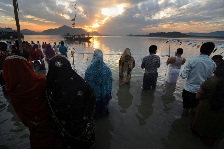 Indian Hindu devotees offer prayers to the sun during The Chhat Festival on the banks of the River Brahmaputra in Guwahati on November 19, 2012. The Chhat festival is mainly observed by people of eastern part of the country, where devotees pray to the sun and water Gods eight days after Diwali, the festival of lights. (Biju Boro/AFP/Getty Images)