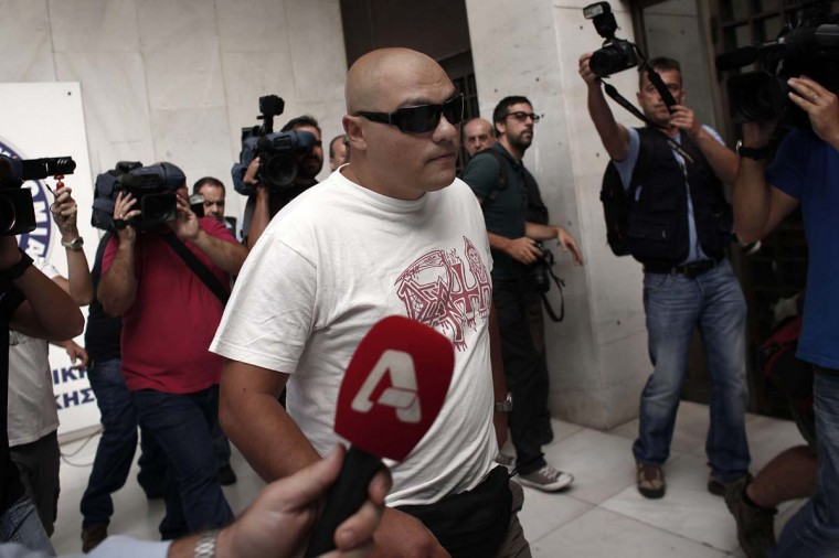 This file photo shows Giorgos Germenis, lawmaker of the Greek extreme far-right Golden Dawn party, arriving at the police headquarters in Athens. Greece's parliament in October lifted the legal immunity of three MPs from the Golden Dawn neo-Nazi party who are facing charges of belonging to a criminal organisation: They are likely to testify in front of magistrates this week, according to ekathimerini.com. The chamber also lifted the immunity of three other party lawmakers on lesser charges, amid a month-long crackdown on Golden Dawn's activities following the murder of an anti-fascist musician in September. Sympathy after what was thought to be a retaliatory attack has gained the party back some favor, according to Reuters.