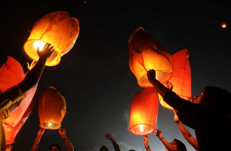 Indian volunteers of a social organisation release sky lanterns to promote a peaceful and eco-friendly Diwali and create awareness against child labour in the fire cracker industry during a function in Kolkata on October 30, 2013. Diwali, the Festival of Lights, marks victory over evil and commemorates the time when Hindu god Lord Rama achieved victory over Ravana and returned to his kingdom Ayodhya. (Dibyangshu Sarka/AFP/Getty Images)