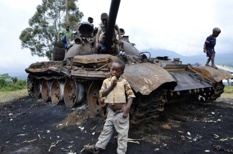 Children play on a burned tank which formerly belonged to M23 rebel soldiers, in Kimbumba, on October 31, 2013. The day before, DR Congo troops captured the last stronghold of M23 rebels in the troubled east of the country, raising hopes of a return to the negotiating table. (Junior D. Kannah/AFP/Getty Images)