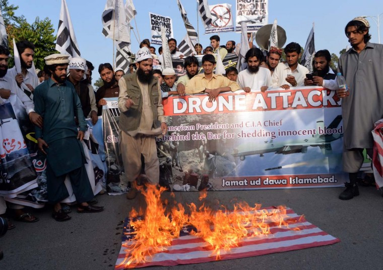 Activists of the banned Pakistan's charity organisation Jamaat-ud-Dawa (JuD), torch a US flag during a protest against US drone attacks in Pakistani tribal regions, in Islamabad on November 1, 2013 . Pakistan's defence ministry said US drone strikes in the country's tribal areas have killed 67 civilians since 2008, a surprisingly low figure given previous casualty estimates. Pakistan regularly condemns the attacks as a violation of sovereignty and Prime Minister Nawaz Sharif used a trip to Washington last week to press for their end. (Aamir Qureshi/AFP/Getty Images)