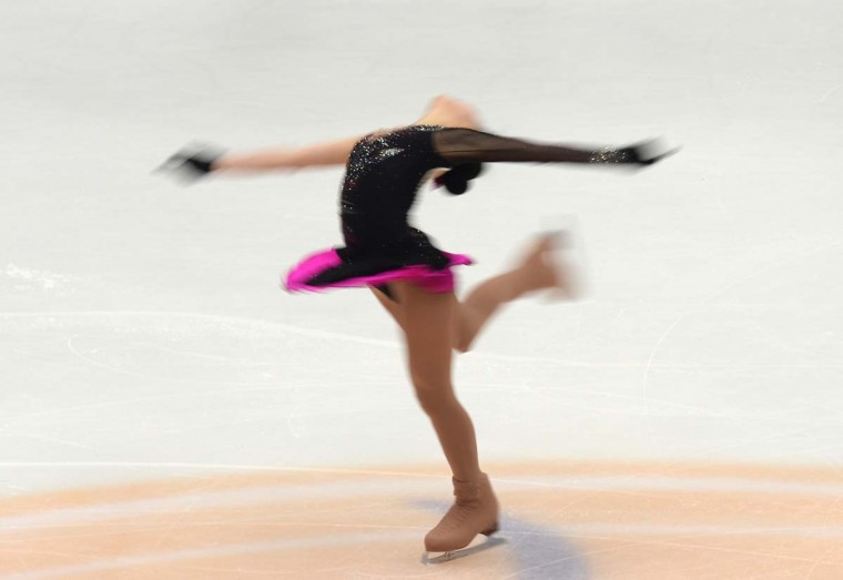 Li Zijun of China performs during her ladies short program event of the Cup of China ISU Grand Prix of Figure Skating in Beijing on November 1, 2013. Li is currently in the 8th place with the score of 53.58. (Goh Chai Hin/Getty Images)