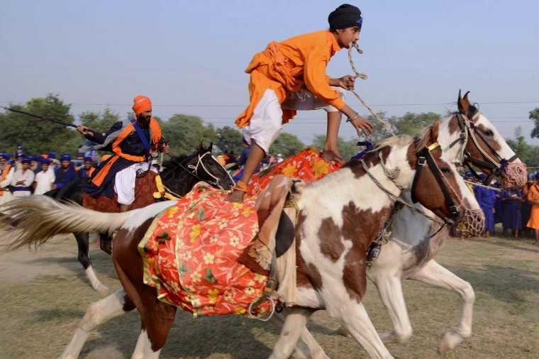 Members of the traditional Sikh religious warriors' Nihang Army perform on horseback on the occasion of 'Fateh Divas' in Amritsar on November 4, 2013. The Sikh celebration of the return of the sixth Guru Hargobind from detention in the Gwalior Fort known as Bandi Chhorh Divas, which coincides with Hindu festival of Diwali, marks the day Guru Hargobind had agreed to his release on the condition that the other fifty-two vassal kings who were detainees would also be released. (Narinder Nanu/AFP/Getty Images )