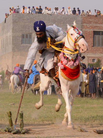 A member of the traditional Sikh religious warriors' Nihang Army performs on horseback on the occasion of 'Fateh Divas' in Amritsar on November 4, 2013. The Sikh celebration of the return of the sixth Guru Hargobind from detention in the Gwalior Fort known as Bandi Chhorh Divas, which coincides with Hindu festival of Diwali, marks the day Guru Hargobind had agreed to his release on the condition that the other fifty-two vassal kings who were detainees would also be released. (Narinder Nanu/AFP/Getty Images )