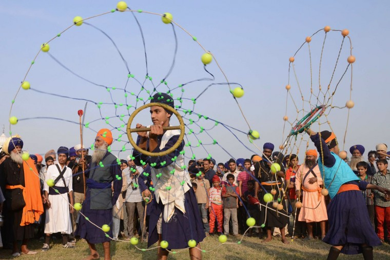 Members of the traditional Sikh religious warriors' Nihang Army perform the martial art known as Gatka during 'Fateh Divas' in Amritsar on November 4, 2013. The Sikh celebration of the return of the sixth Guru Hargobind from detention in the Gwalior Fort known as Bandi Chhorh Divas, which coincides with Hindu festival of Diwali, marks the day Guru Hargobind had agreed to his release on the condition that the other fifty-two vassal kings who were detainees would also be released. (Narinder Nanu/AFP/Getty Images)