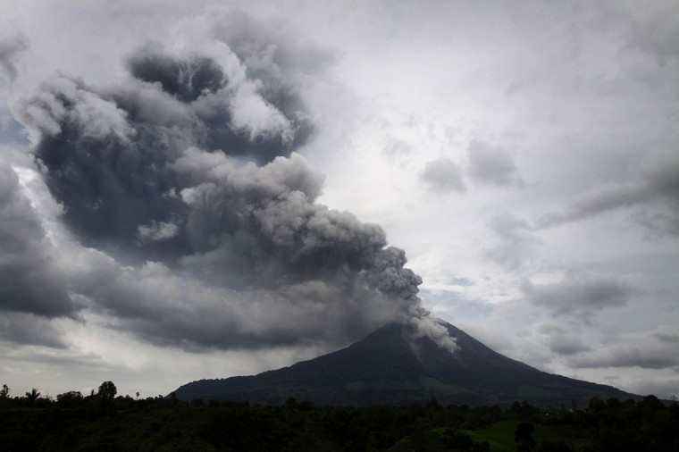 A giant plume of steam and ash rises from the crater of Mount Sinabung volcano during an eruption as seen from Karo district on Indonesia's Sumatra island. (KARISHMA TARIGAN / AFP/Getty Images)