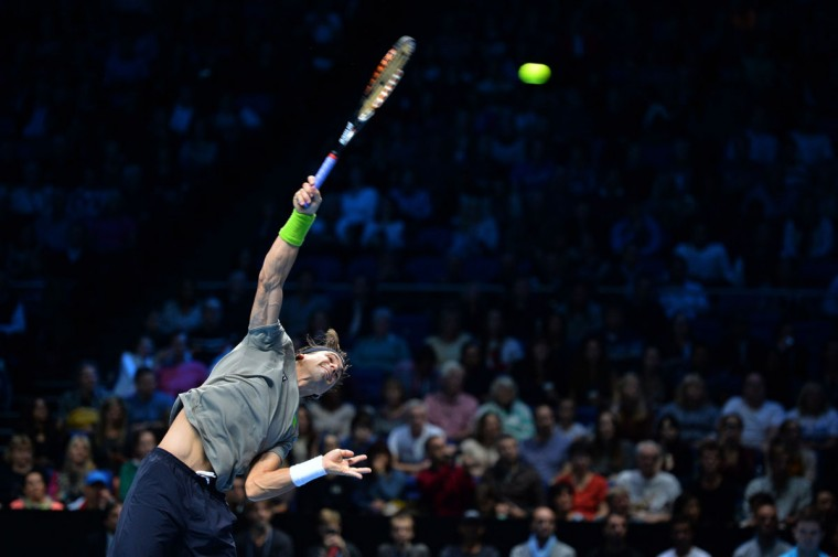 David Ferrer serves against Rafael Nadal during their group A singles match in the round robin stage on the second day of the ATP World Tour Finals tennis tournament in London. (BEN STANSALL / AFP/Getty Images)