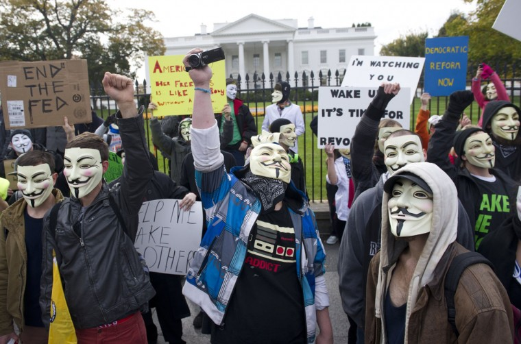 Demonstrators, including supporters of the group Anonymous, march in a protest against corrupt governments and corporations in front of the White House in Washington, DC, November 5, 2013, as part of a Million Mask March of similar rallies around the world on Guy Fawkes Day. (Saul Loeb/AFP/Getty Images)