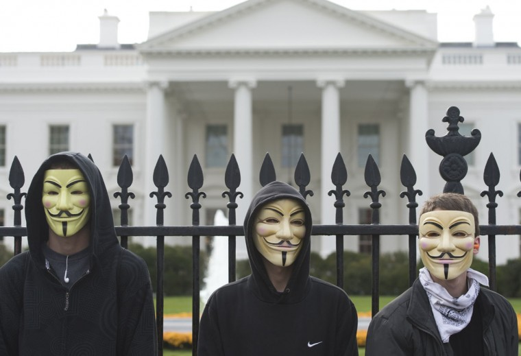 Demonstrators, including supporters of the group Anonymous, march in a protest against corrupt governments and corporations in front of the White House in Washington, DC, November 5, 2013, as part of a Million Mask March of similar rallies around the world on Guy Fawkes Day. Saul Loeb/AFP/Getty Images)