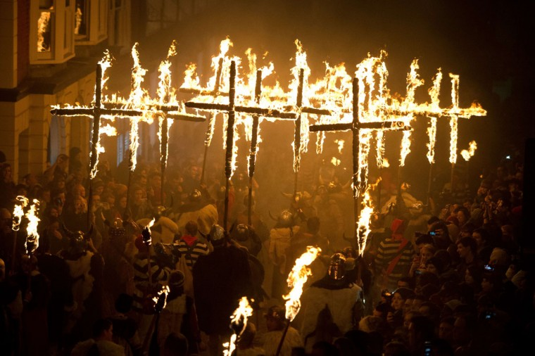 Bonfire societies parade through the streets during the Bonfire Night celebrations on November 5, 2013 in Lewes, Sussex in England. Bonfire Night is related to the ancient festival of Samhain, the Celtic New Year. Processions held across the South of England culminate in Lewes on November 5, commemorating the memory of the seventeen Protestant martyrs. Thousands of people attend the parade as Bonfire Societies parade through the narrow streets until the evening comes to an end with the burning of an effigy, or 'guy,' usually representing Guy Fawkes, who died in 1605 after an unsuccessful attempt to blow up The Houses of Parliament. (Leon Neal/AFP/Getty Images)