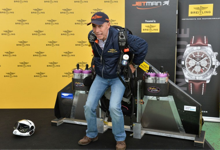 """Swiss pilot Yves Rossy, or """"Jetman"""", introduces his 60 kg (132 pound) flight equipment, including the wings which strap onto his back, at a press conference in Tokyo on November 6, 2013. Swiss aviator Yves """"Jetman"""" Rossy, whose jet-engine powered wings have taken him over some of the world's most awe-inspiring places, has added another, Japan's Mount Fuji. (Kazuhiro Nogika/AFP/Getty Images)"""