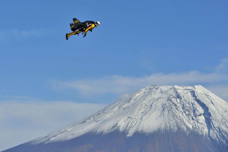 "This handout picture taken near Fujinomiya in Shizuoka prefecture on October 30, 2013 and released on November 6, 2013 shows Swiss pilot Yves Rossy, or ""Jetman"", flying near Mount Fuji. Swiss aviator Yves ""Jetman"" Rossy, whose jet-engine powered wings have taken him over some of the world's most awe-inspiring places, has added another -- Japan's Mount Fuji. Rossy, with a 60-kilogram (132-pound) kit strapped on his back, circled the country's highest and most revered mountain nine times over one week. (Katsuhiko Tokunaga/AFP/Getty Images)"