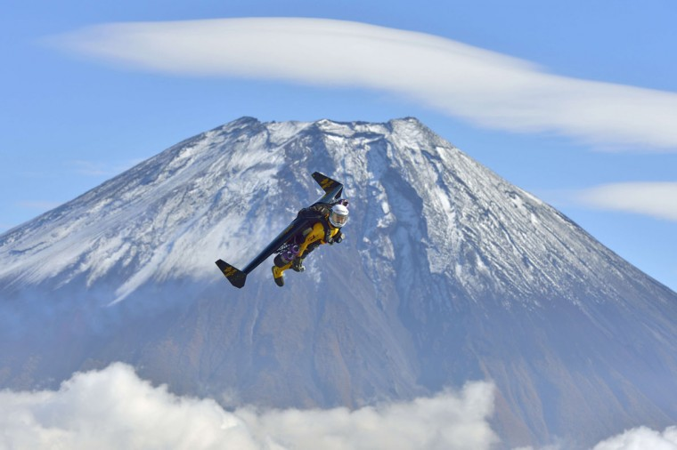 "This handout picture taken near Fujinomiya in Shizuoka prefecture on November 1, 2013 and released on November 6, 2013 shows Swiss pilot Yves Rossy, or ""Jetman"", flying near Mount Fuji. Swiss aviator Yves ""Jetman"" Rossy, whose jet-engine powered wings have taken him over some of the world's most awe-inspiring places, has added another -- Japan's Mount Fuji. Rossy, with a 60-kilogram (132-pound) kit strapped on his back, circled the country's highest and most revered mountain nine times over one week. (Katsuhiko Tokunaga/AFP/Getty Images)"