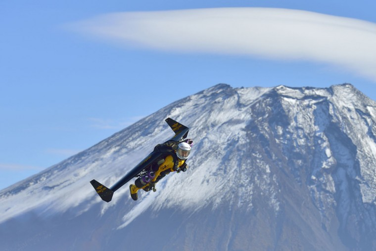 """This handout picture taken near Fujinomiya in Shizuoka prefecture on November 1, 2013 and released on November 6, 2013 shows Swiss pilot Yves Rossy, or """"Jetman"""", flying near Mount Fuji. Swiss aviator Yves """"Jetman"""" Rossy, whose jet-engine powered wings have taken him over some of the world's most awe-inspiring places, has added another -- Japan's Mount Fuji. Rossy, with a 60-kilogram (132-pound) kit strapped on his back, circled the country's highest and most revered mountain nine times over one week. (Katsuhiko Tokunaga/AFP/Getty Images)"""