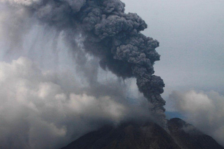 Sinabung volcano erupts and throws hot smoke into the air, in Karo, North Sumatra on November 5, 2013. Hundreds of residents have been evacuated to safer areas as the volcano erupted anew following September eruptions. (Ade Sinuhaji/AFP/Getty Images)