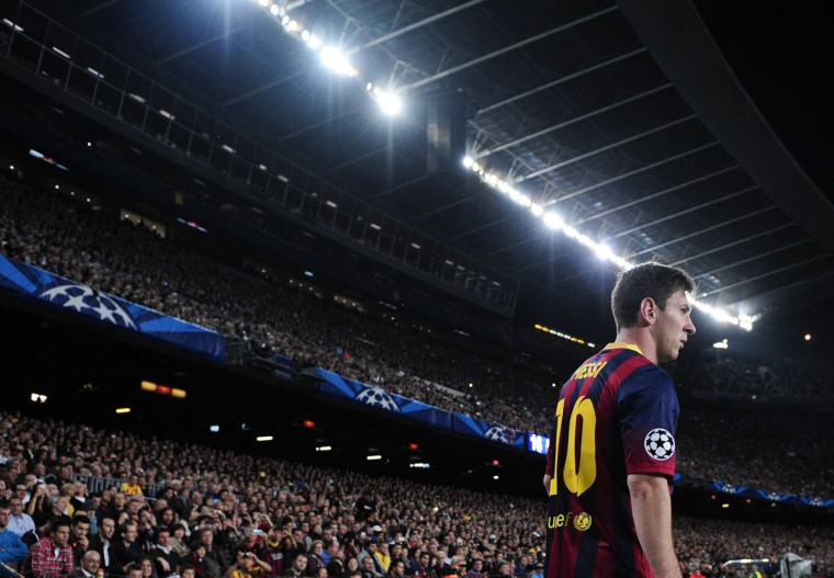 Barcelona's Argentinian forward Lionel Messi waits to shoot a corner during the UEFA Champions league football match FC Barcelona vs AC Milan at the Camp Nou stadium in Barcelona on November 6, 2013. (Josep Lago/AFPGetty Images)